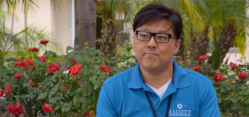 Korean staff member in front garden area