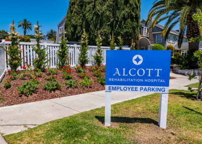 Flowers and employee parking sign for Alcott Rehabilitation