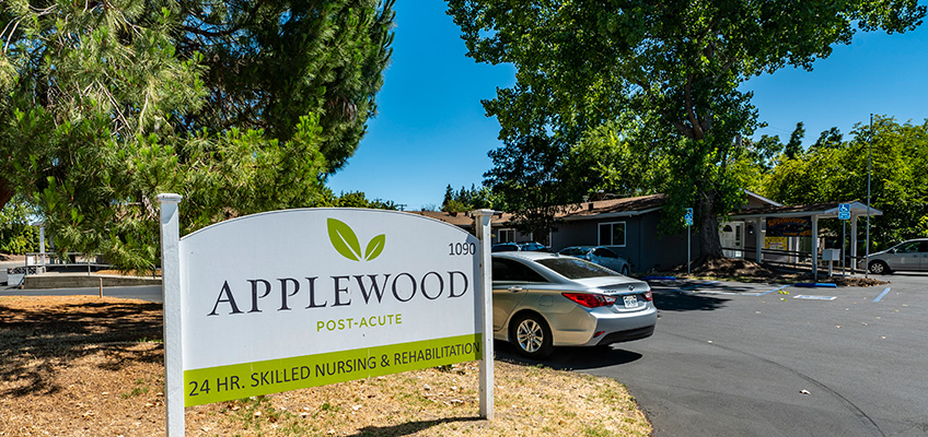 Front of the Applewood Post-Acute facility showing the sign