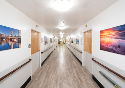 The Applewood Post-Acute facility hallway with pictures on the walls