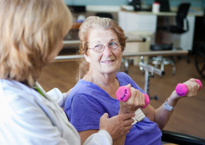 Citrus Nursing Center occupational therapist with an elderly resident lifting weights