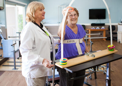 Citrus Nursing Center occupational therapist with a smiling female elderly resident