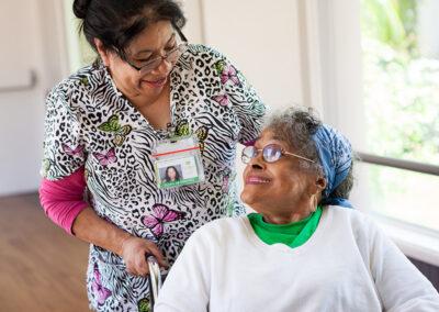 Citrus Nursing Center nurse with a smiling female elderly resident in a wheelchair