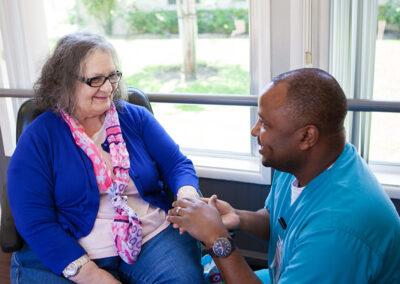 Citrus Nursing Center male nurse with a female elderly resident