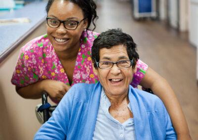 Citrus Nursing Center cute nurse with a smiling female elderly resident