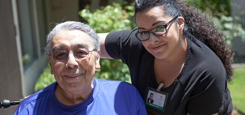 Citrus Nursing Center nurse with a happy male elderly resident