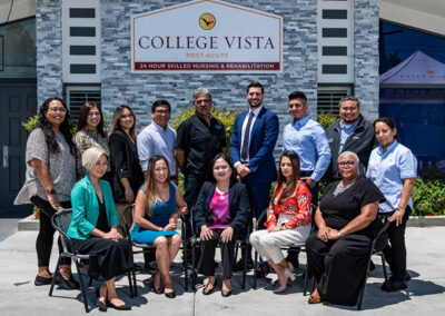 College Vista staff photo in front of facility sign