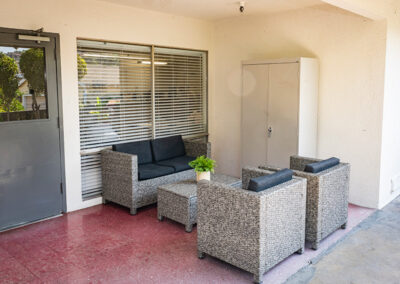 Outside comfortable seating area of the College Vista facility