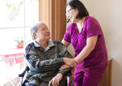 College Vista a nurses and a resident smiling