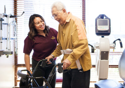 College Vista a occupational therapist and a resident smiling
