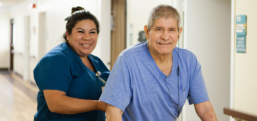 College Vista a rehab therapist and a resident smiling