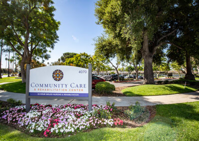 Community Care front sign and trees and bushes