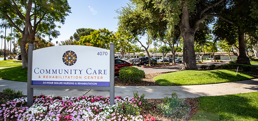 Community Care front sign flowers, trees and bushes