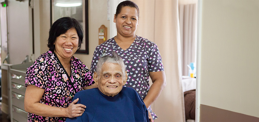 A resident, and two nurses at Country Oaks