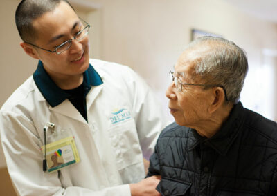Del Mar employee with an elderly resident