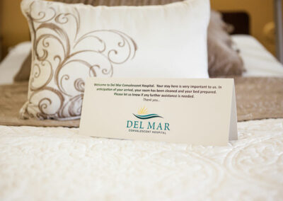 Del Mar welcome note on the bed