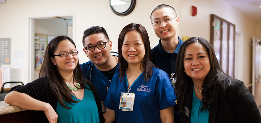 several happy employees at the nurses station