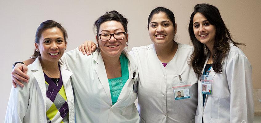 Del Mar nurses smiling arm in arm