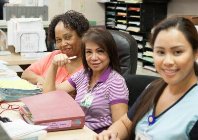 Three nurses at the nurses station