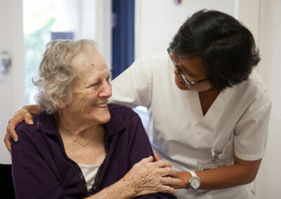 A nurse and a smiling elderly patient
