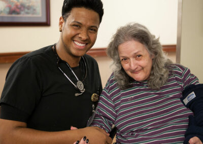 A rehab therapist and a patient in a wheelchair