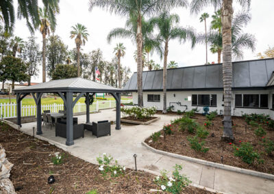 Extended Care shaded patio for seating and palm trees