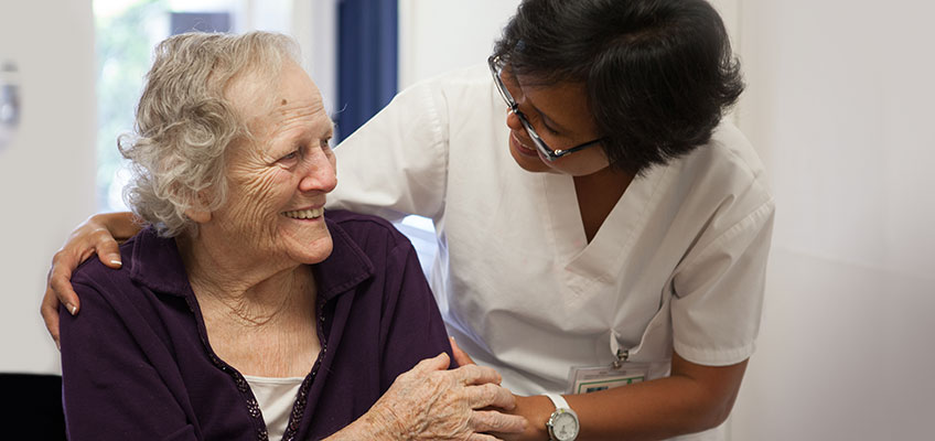 Nurse and smiling elderly resident