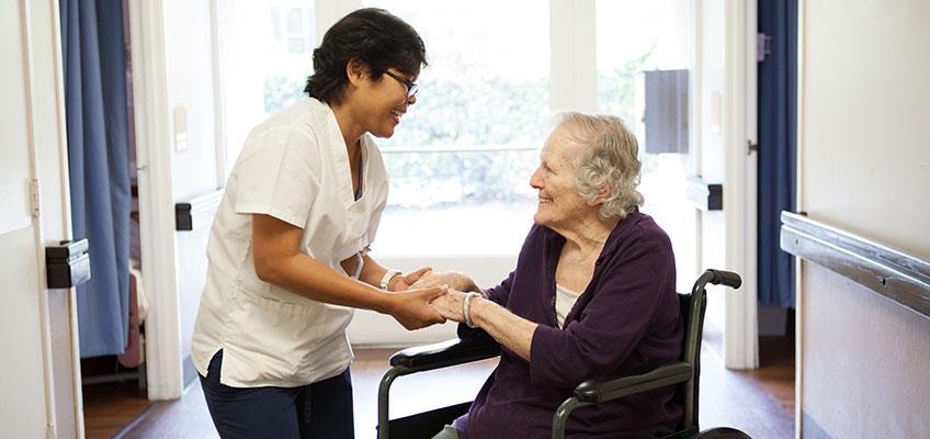 A nurse and an elderly patient