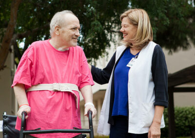French Park nurse and elderly resident using a walker