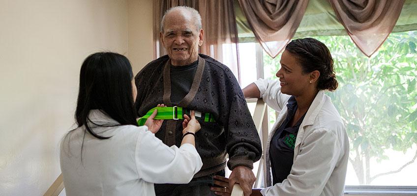 Garden Park rehab therapists and elderly resident