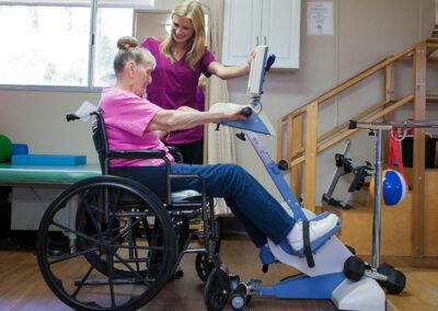 Gordon Lane rehab therapist and elderly resident in a wheelchair
