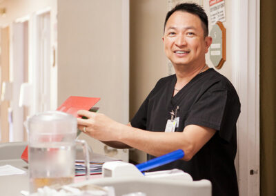 smiling staff member at Mission Care Center