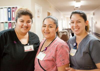 three happy nurses at the nurses station at Mission Care Center
