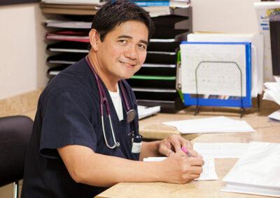 caregiver at the desk at Mission Care Center