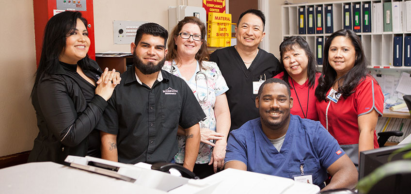 smiling staff members at Mission Care Center