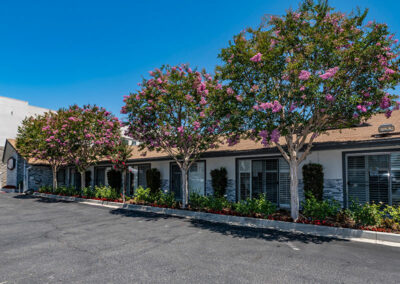 Monterey Park facility with sign, parking lot, and trees