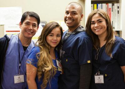 North Valley Nursing Center nurses smiling at the nurses station