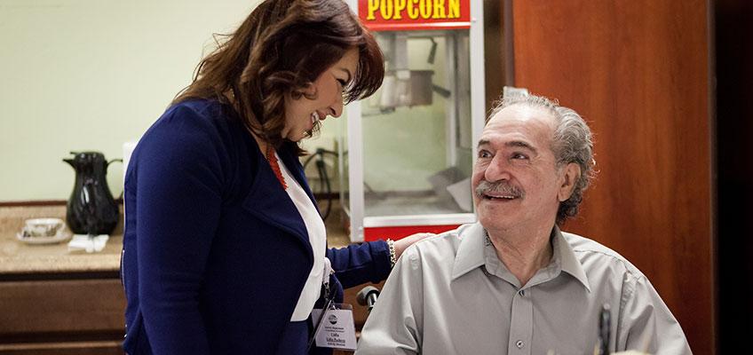 North Valley Nursing Center caregiver with an elderly resident