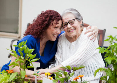 Pacific Post-Acute caregiver with a resident both happy