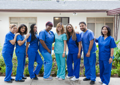 Nurses and staff member pose for a photo at Pacific Post-Acute