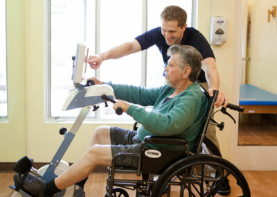 A rehab therapist with an elderly resident at Pacific Post-Acute