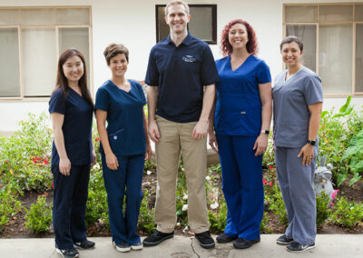 Staff member pose for a photo at Pacific Post-Acute