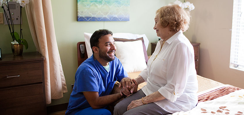 A male nurse with an elderly resident at Pacific Post-Acute