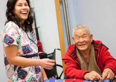 Nurse with an elderly resident laughing