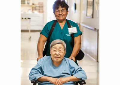 Nurse with an elderly resident smiling